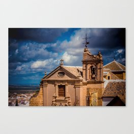 Old Spanish church on the hill. Numerous cottony clouds cover the sky. Canvas Print