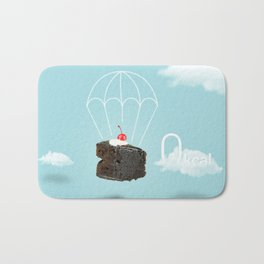 Isolated Chocolate cherry cake with parachute on blue sky background Bath Mat