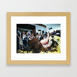 Chuck Taylor and Ricochet crash through a table Framed Art Print