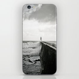 Waves break against an English pier iPhone Skin