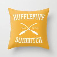 hufflepuff Throw Pillows featuring Hogwarts Quidditch Team: Hufflepuff by IA Apparel