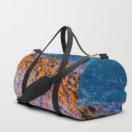 ocean with blue water and rock and stone Duffle Bag