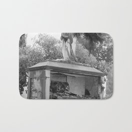 Old broken grave with angel Bath Mat