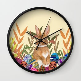 Bunny in garden with colored Easter eggs Wall Clock