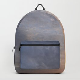 Glowing sky clouds at sunset Backpack