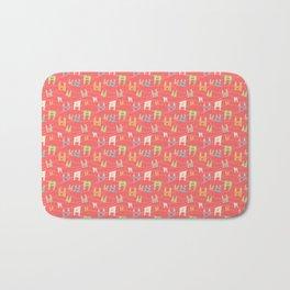 Colorful bunnies on salmon/pink Bath Mat