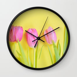 Three pink tulips on yellow Wall Clock