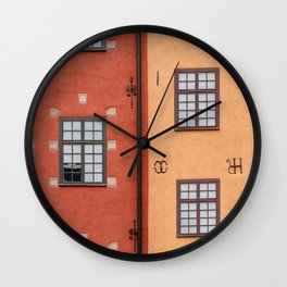 Gamla Stan in Stockholm, Sweden || Colorful travel photography architecture minimalistic city red orange yellow Scandinavia House Old Town Wall Clock