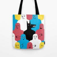 wolf Tote Bags featuring A Wolf by Jack Teagle