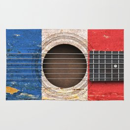 Old Vintage Acoustic Guitar with French Flag Rug
