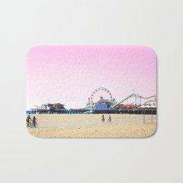 Santa Monica Pier with Ferries Wheel and Roller Coaster Against a Pink Sky Bath Mat