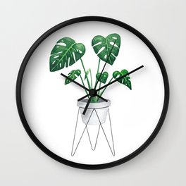 Monstera in designer plant stand with green leaves and foliage Wall Clock