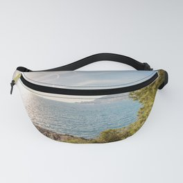 Sunlight reflected on the sea of Cap Martin in a sunny winter day Fanny Pack