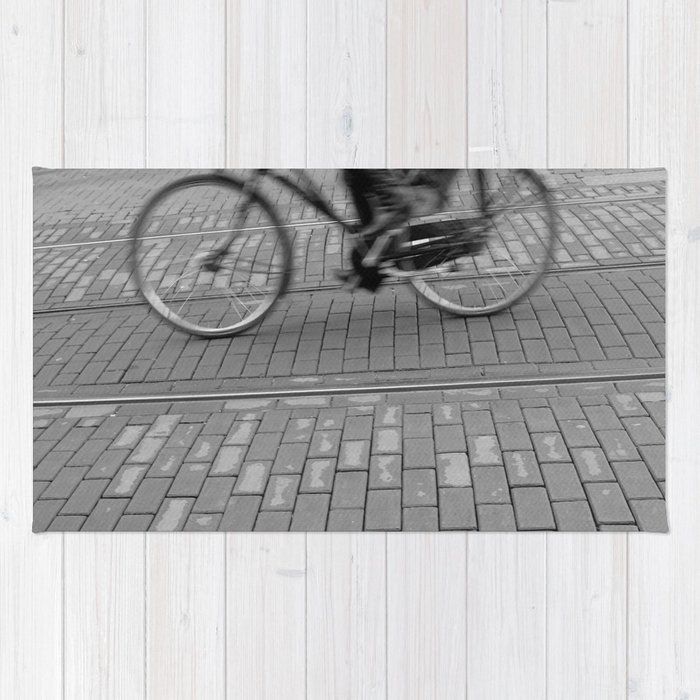 cycling in the city Rug