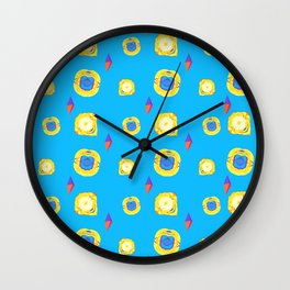 yellow substances in a blue matter Wall Clock