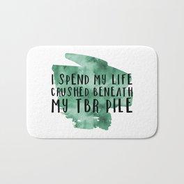 I Spend My Life Crushed Beneath My TBR! (Green) Bath Mat