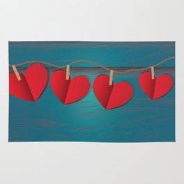 Red paper hearts tie to a rope Rug