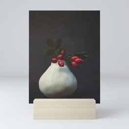 Rosehips in vase Mini Art Print