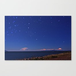 Abstract storms on the horizon and star trail. Ross River dam, Townsville. Canvas Print