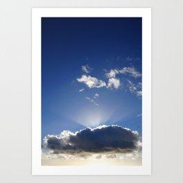 Sun rays behind a dark cloud Art Print