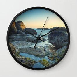 Ocean between the rocks by the beach Wall Clock