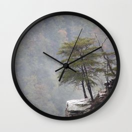 Tree on a rocky ledge in the fog Wall Clock