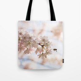 Bee and cherry branches against the blue sky Tote Bag