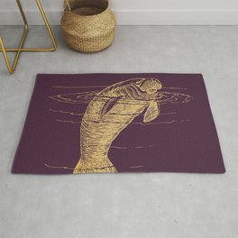 Gold manatee on winter bloom Rug