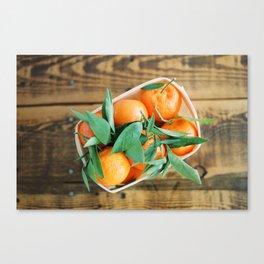 A Basket of Oranges Canvas Print