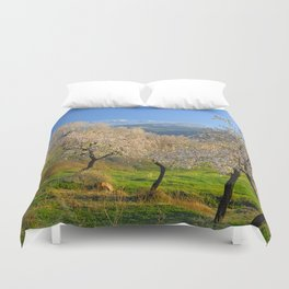Flowering almond at the snowy mountains Duvet Cover