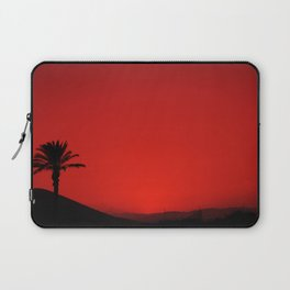 Red Andalusian sunset with silhouette palm tree and mountain Laptop Sleeve
