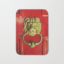 Gold Lion Door Knocker on Red Door Bath Mat
