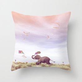 Elephant running after a kite Throw Pillow