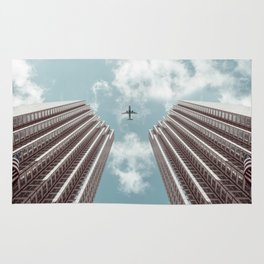 Plane high rise buildings Rug