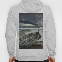 Shipwrecked Wooden Boat amidst Crashing Waves Hoody