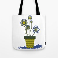 leah flores Tote Bags featuring Flores by Constant
