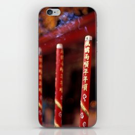 Candle sticks in font of buddhist temple iPhone Skin