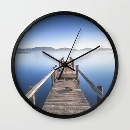 Wooden pier or jetty and lake at sunrise. Torre del Lago Puccini. Tuscany, Italy Wall Clock