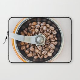 Roasted coffee beans in a manual coffee grinder. The view from the top. Laptop Sleeve