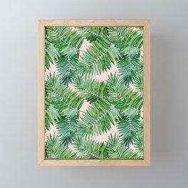 Green palm leaves on a light pink background. Framed Mini Art Print