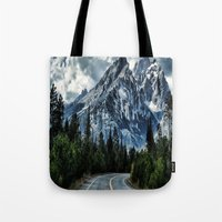 Tote Bags featuring Mountain road by Lostfog Co.