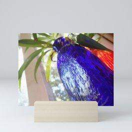 Blue glass and plant Mini Art Print