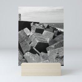 concrete cubic coastline Mini Art Print