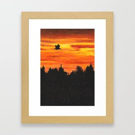 Sunset sky with bird Framed Art Print