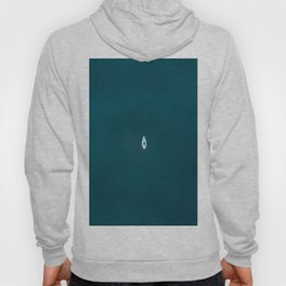 Minimalist Boat swimming in a calm blue Lake – Aerial photography Hoody