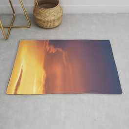 Colorful sunset purple pink yellow clouds  Rug