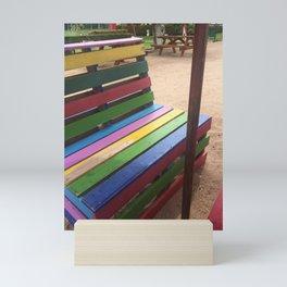 Seated on a Rainbow Mini Art Print