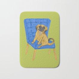 Happy Pug on a blue chair Bath Mat