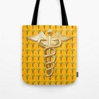 medical Tote Bags featuring Gold Medical Caduceus by MacDonald Creative Studios