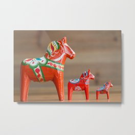 Three Dala horses in decreasing sizes in a row Metal Print